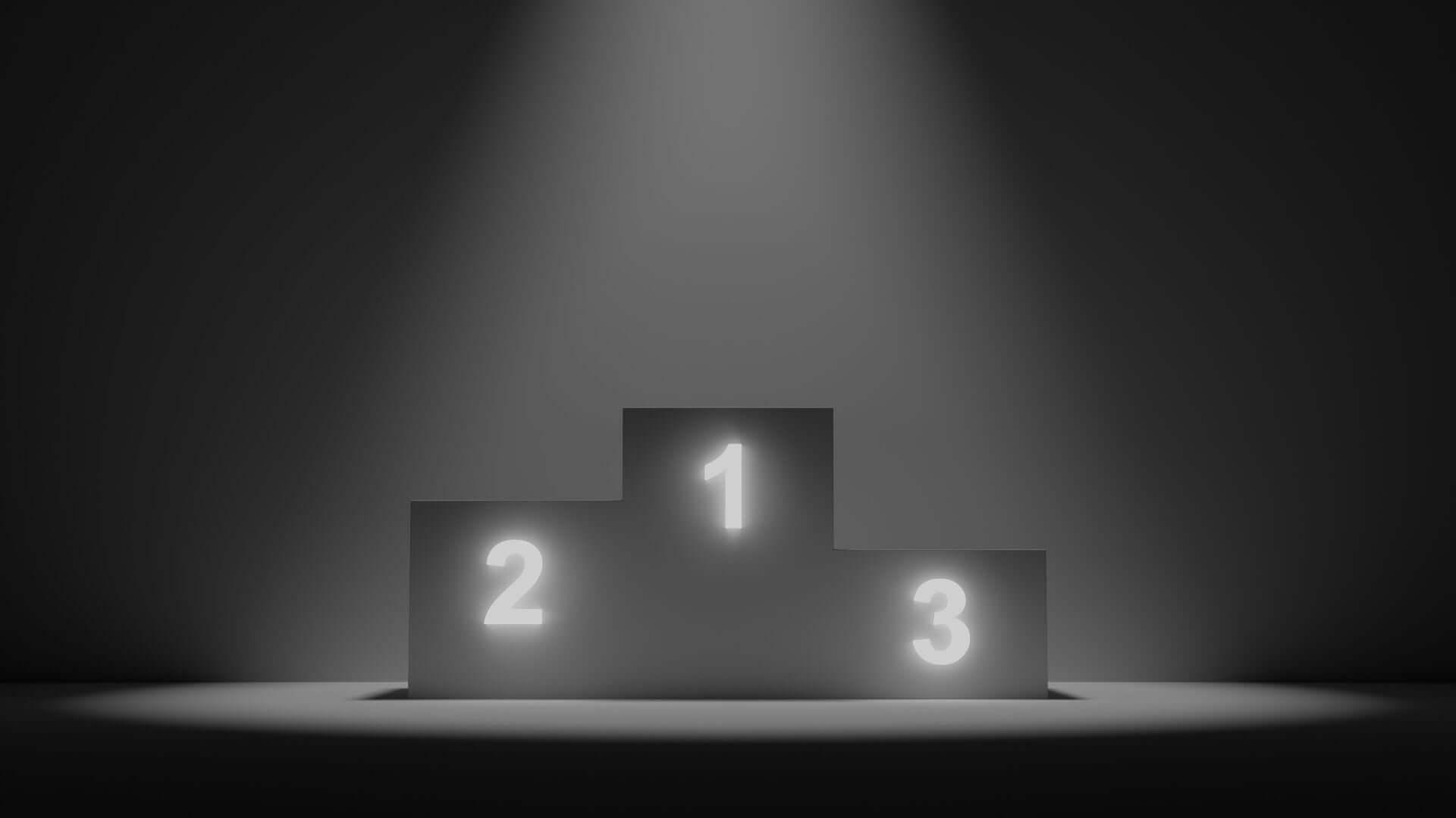 Un podium noir avec 3 places